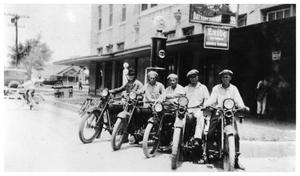 Primary view of object titled '[Gulf Station Men on Motor Bikes]'.