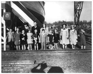 Primary view of object titled 'Group of people at the Christening of a ship'.