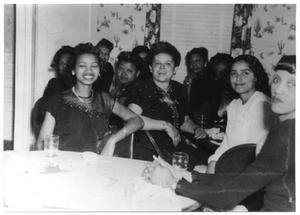 Primary view of object titled 'Group of black women at a luncheon meeting'.