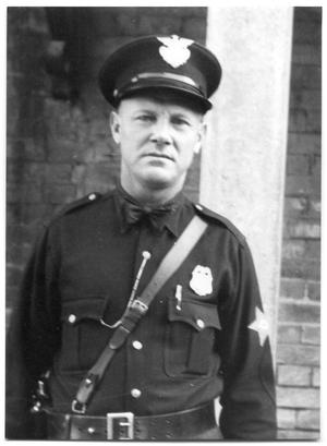 Primary view of object titled 'J.M Morgan in a police uniform'.