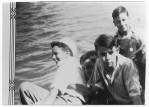 Primary view of object titled 'Four boys in a boat on the water'.