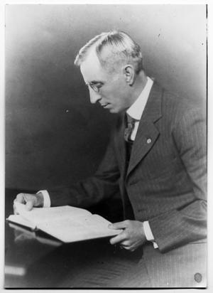 Portrait of F.H Farwell reading a book
