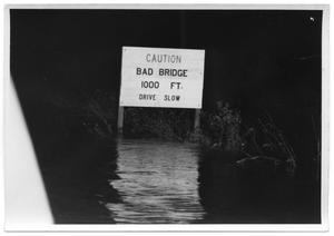 Primary view of object titled '[Photograph of Bad Bridge Sign During Flood]'.