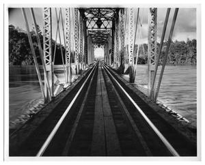 Primary view of object titled '[Photograph of Railroad Bridge Crossing Flooded Sabine River]'.