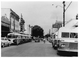 Primary view of object titled '[City Buses at Fifth and Main]'.