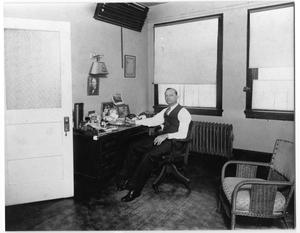 Primary view of object titled '[Dr. Wynne Pearce in His Office]'.