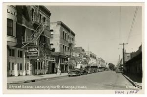 Primary view of object titled '[Street Scene - Looking North - Orange, Texas]'.