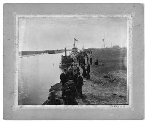 [Photograph of Men and Women on the Bank of the Port Arthur Canal]
