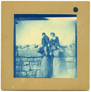 Primary view of object titled 'Annie and friends on a rock wall'.
