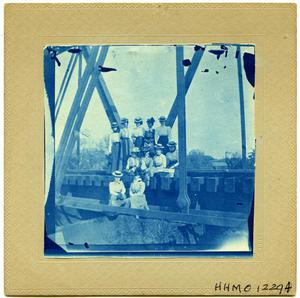 Primary view of object titled 'Annie & Beulah with 9 friends on a bridge'.