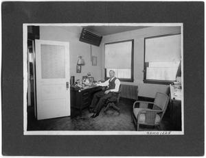 Primary view of object titled 'Young Dr. Wynne Pearce in office'.