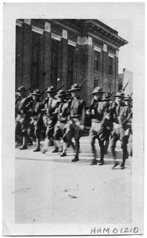 Primary view of object titled 'Orange National Guard marching in a town'.