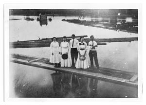 Primary view of object titled '[Photograph of People on River Dock]'.