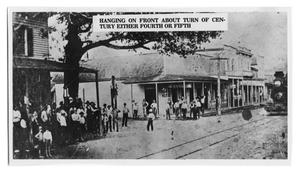 Primary view of object titled 'Hanging on Front Street in Orange, Texas'.