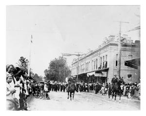 Primary view of object titled '[Parade on unpaved streets]'.