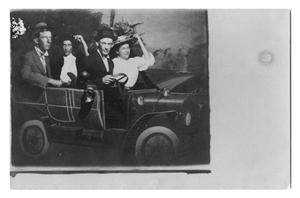 Primary view of object titled '[Group of people inside of prop car]'.