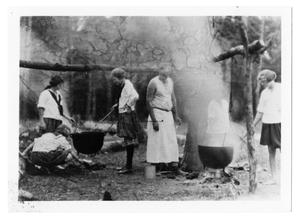 Primary view of object titled '[Camp fire girls cooking at camp]'.