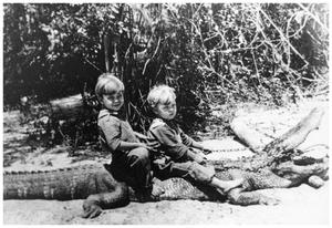 Primary view of object titled '[Two children on alligator]'.