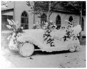 Primary view of object titled '[Ladies in decorated automobile]'.