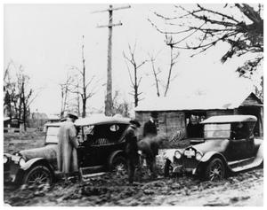 Primary view of object titled '[Two cars stalled in mud]'.