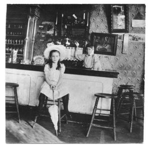 Primary view of object titled 'Georgia Hewson at Hewson Drug Store'.