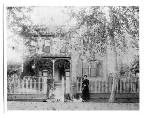 Primary view of object titled 'Three Women, One Child and Dog in Front of a House'.