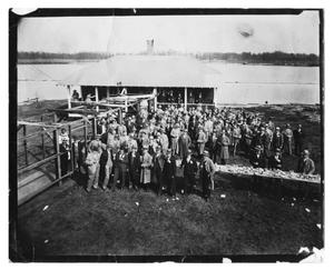 Primary view of object titled '[Photograph of Men at Event on Riverbank]'.