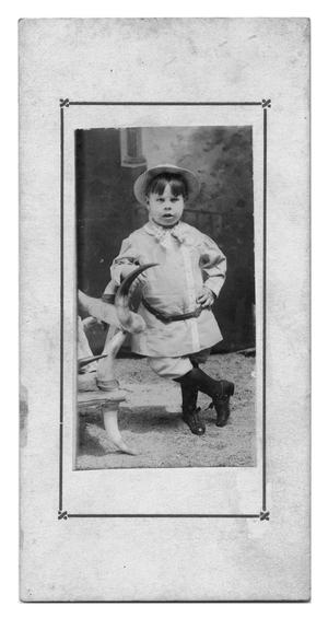Primary view of object titled 'Young Boy with Cow Horn Chair'.