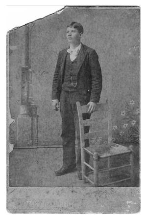 Primary view of object titled 'Young Man in Suit with Chair'.