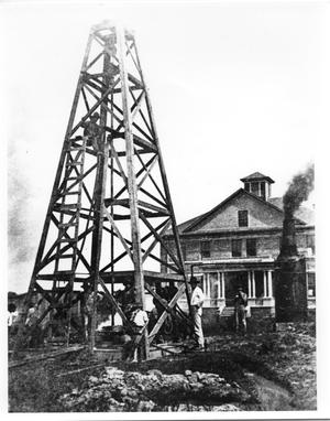 Primary view of object titled '[Oil Derrick on the Front Lawn of a House]'.