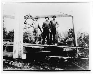 Primary view of object titled '[Four Men on an Oil Derrick]'.