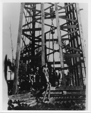 Primary view of object titled '[Men Standing on an Oil Derrick]'.