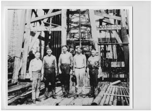 Primary view of object titled '[Five Men Working for the Gulf Production Company]'.