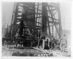 Primary view of object titled '[Several Men Working on an Oil Derrick]'.