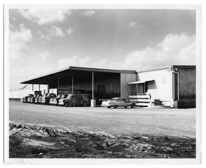Primary view of object titled '[Cars parked outside of Sabine Supply Co.]'.