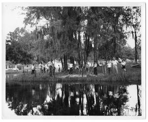 Primary view of object titled '[Photograph of Group of People Standing near a Body of Water]'.