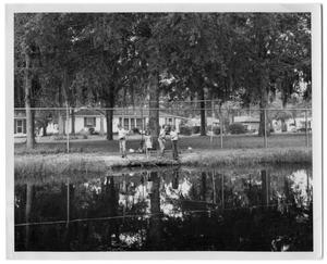 Primary view of object titled '[Children fishing near a body of water]'.