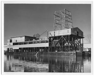 Primary view of object titled '[Photograph of Large Building on Water]'.