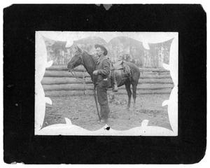 Primary view of object titled '[Man with horse and gun]'.