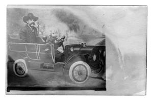 Primary view of object titled '[Man & child in prop car]'.