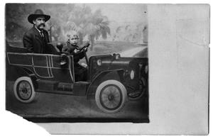 Primary view of object titled '[Man and child in prop car]'.