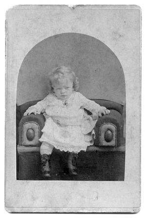 [Young child sitting]