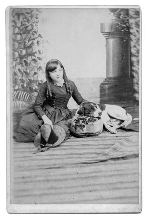Primary view of object titled '[Young Lillian Josephine Harris sitting next to dog]'.