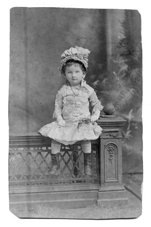 Primary view of object titled '[Child seated on a ledge]'.