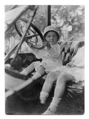Primary view of object titled '[Child holding a steering wheel]'.