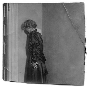 Primary view of object titled '[Woman leaning against a wall]'.
