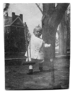 Primary view of object titled '[Child playing with croquet mallet]'.