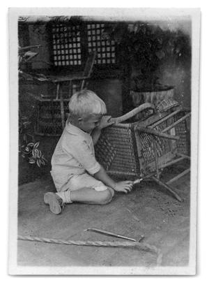 Primary view of object titled '[Child using a tool on a chair]'.