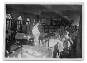 Primary view of object titled '[People dining in restaurant]'.