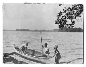Primary view of object titled '[Photograph of Children Playing near a Dock]'.